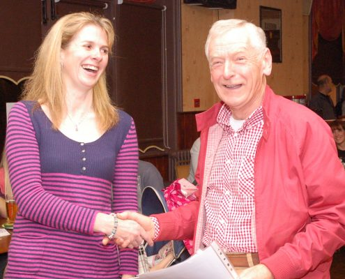 Mike Wood receives a certificate from Sally Withey